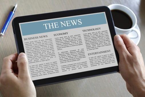 newspaper on tablet